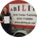 lady with her driving test pass certificate standing by the car and trailer